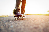Closeup of teenager skateboarder legs