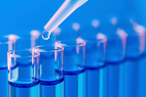 istock Close-up of test tubes being filled with liquid 173721526