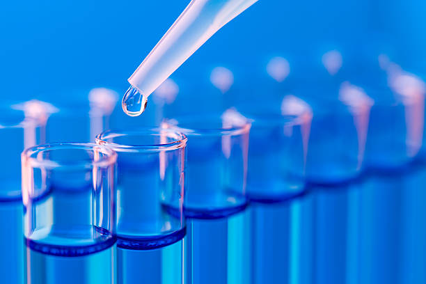 Close-up of test tubes being filled with liquid stock photo