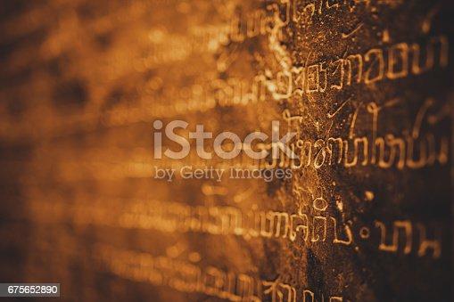 istock Closeup of Thai ancient stone inscription at Sukhothai province 675652890