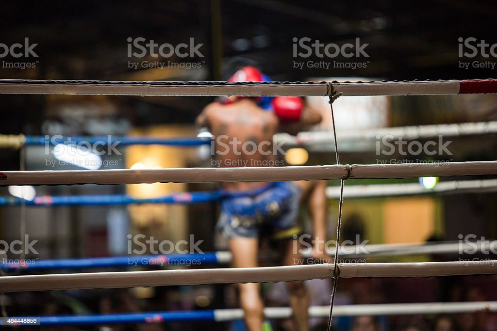 Close-up of Thai boxing ring with boxer in the background stock photo