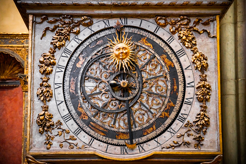 Close-up of the astronomical clock in the majestic Saint Jean Baptiste cathedral monument in Lyon old town, also called Vieux Lyon in french. Photo taken in Lyon famous city, Unesco World Heritage Site, in Rhone department, Auvergne-Rhone-Alpes region in France, Europe during a sunny summer day.