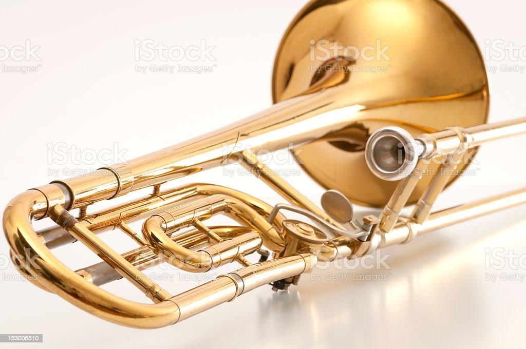 A closeup of the back of a golden trombone stock photo