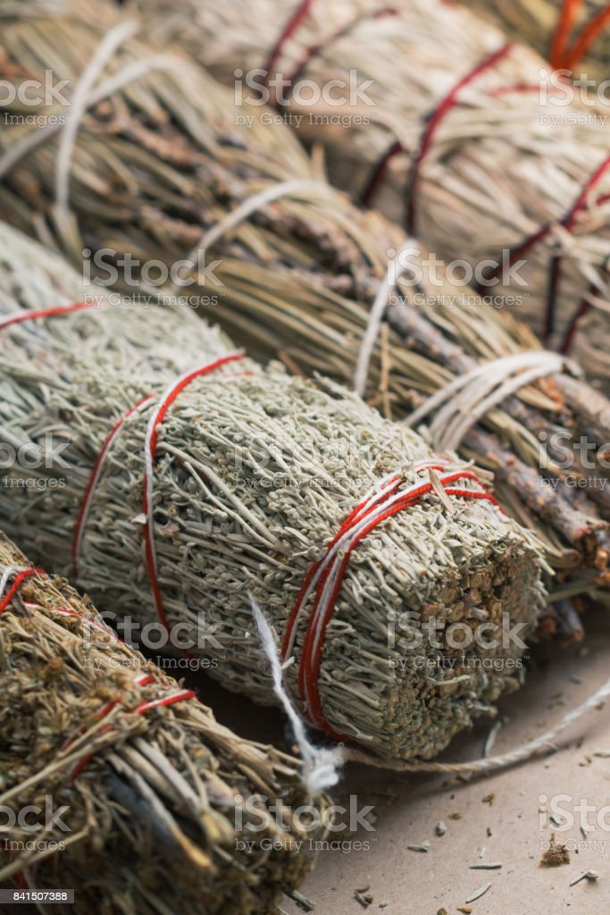 Close-up of the bandaged branches of dried herbs: sage, wormwood, pine and juniper stock photo