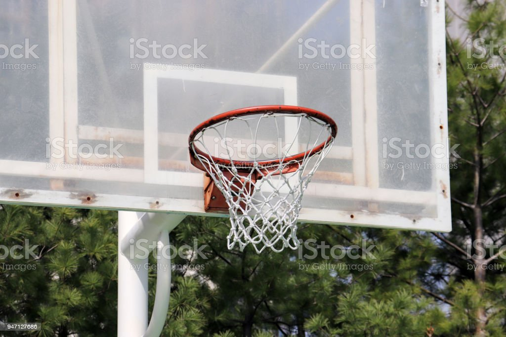 A close-up of the basketball court in the park.