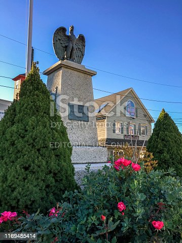 Kennebunkport, Maine / USA - Oct 18, 2018: The Soldiers and Sailors Monument honoring Civil War vets. Bronze Eagle and granite pedestal in the center of Dock Square was unveiled on Memorial Day 1909.