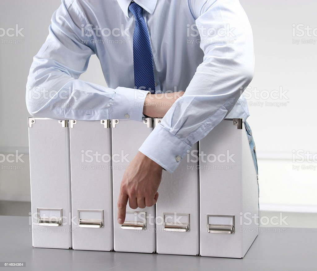 Close-up of the businessman with office folders stock photo