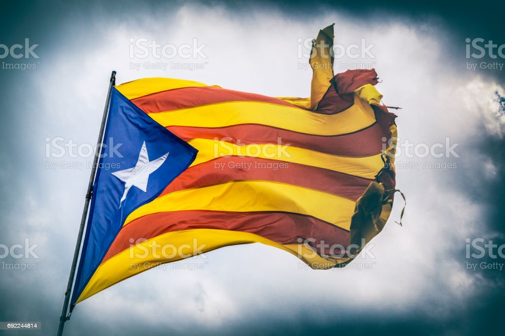 Close-up of the Catalonia flag blowing in the wind, as shot in Barcelona. stock photo