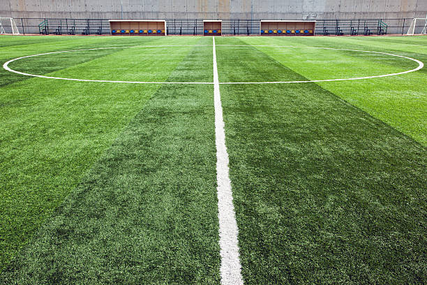 close-up of the center line of soccer field - soccer field stock photos and pictures
