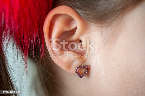 Earring in a young girl's ear