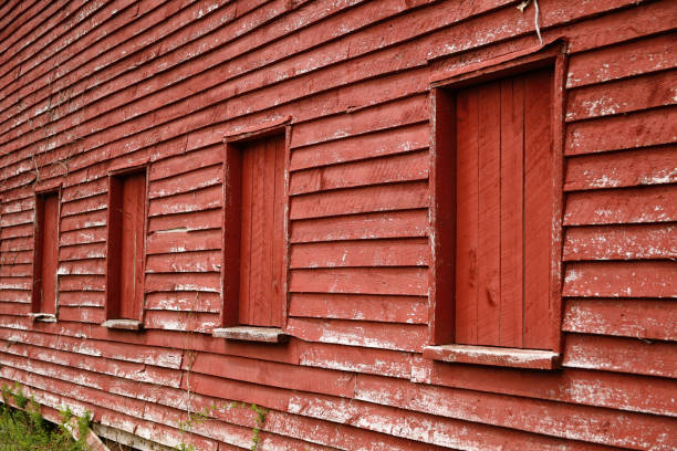 Close-up of the exterior of a late 19th Century wooden livestock barn painted red stock photo