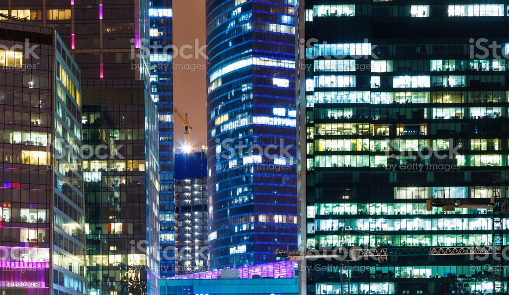 A closeup of the facade of a modern skyscraper showing business activity on each level stock photo