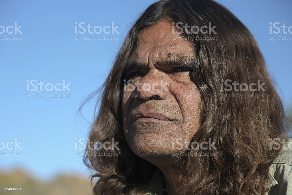 Close-up of the face of an Aboriginal man with long hair royalty-free stock photo