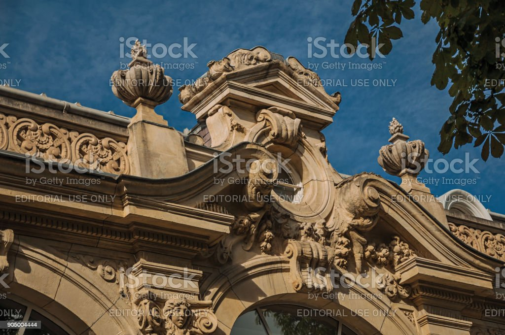 Close-up of the far-fetched building decoration in a sunny day at the Champs-Elysees in Paris. stock photo