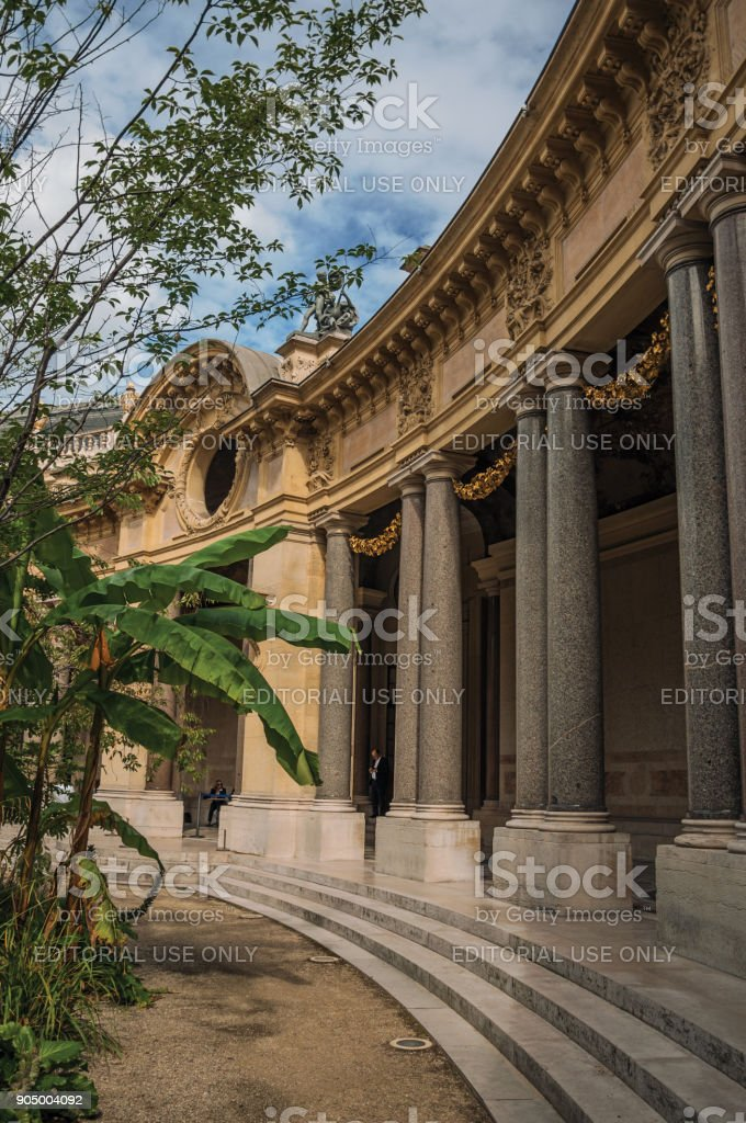 Close-up of the far-fetched decoration of arch and columns at the Petit Palais courtyard in Paris. stock photo