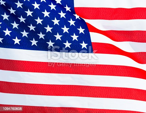 687972458istockphoto Close-up of the flying American flag 1094760608