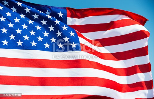 687972458 istock photo Close-up of the flying American flag 1094760646