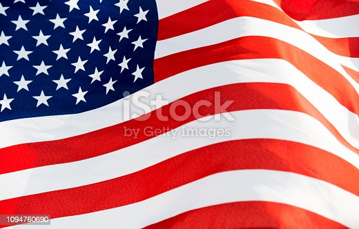 687972458istockphoto Close-up of the flying American flag 1094760690