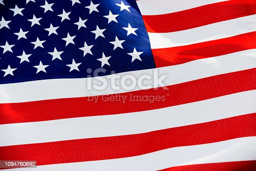 687972458 istock photo Close-up of the flying American flag 1094760692