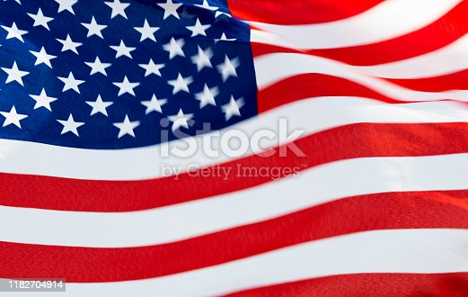 687972458istockphoto Close-up of the flying American flag 1182704914
