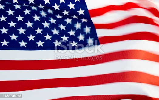 687972458istockphoto Close-up of the flying American flag 1182705245