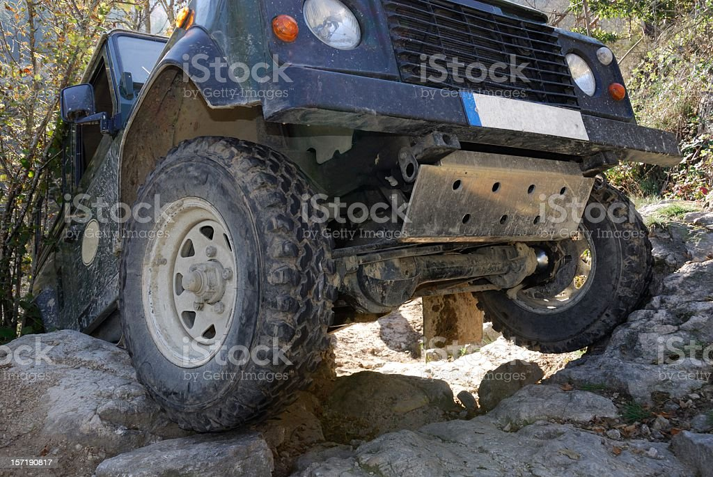 Close-up of the front of an 4x4 SUV off-roading royalty-free stock photo