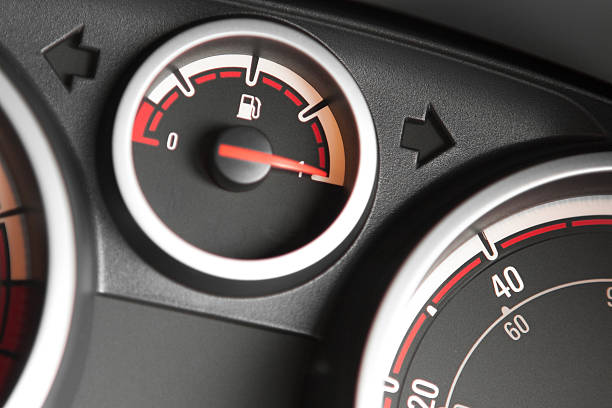 Close-up of the fuel gauge on a filled up car stock photo