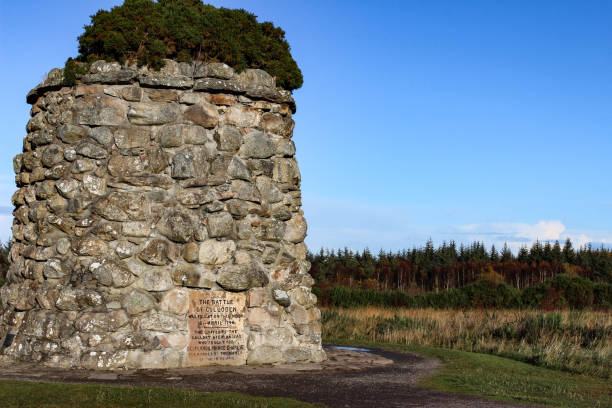 Close-up of the Giant Cairn at Culloden Moor. Giant cairn or grave marker at Culloden Moor, Scotland during a crisp autumn day. culloden stock pictures, royalty-free photos & images