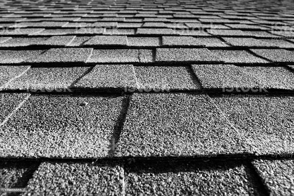 A close-up of the gray shingles on the roof of the house stock photo