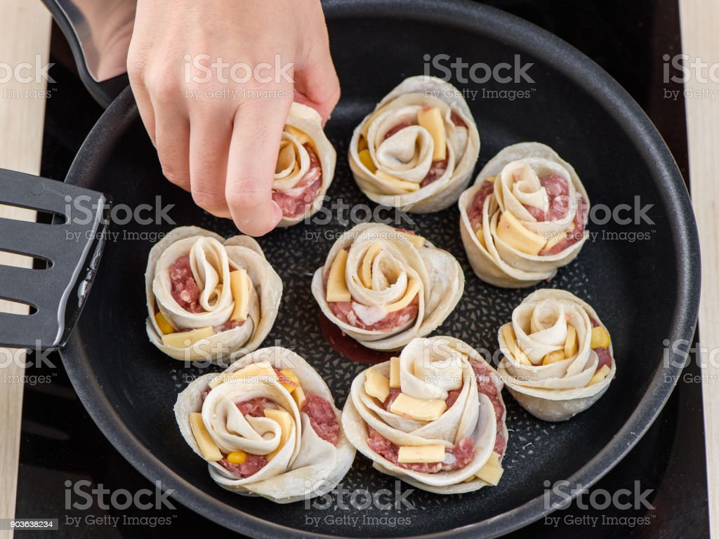 close-up of the hands of a chef in a professional kitchen cooking rose flower shape dumpling, chinese food, cheese corn dumpling stock photo