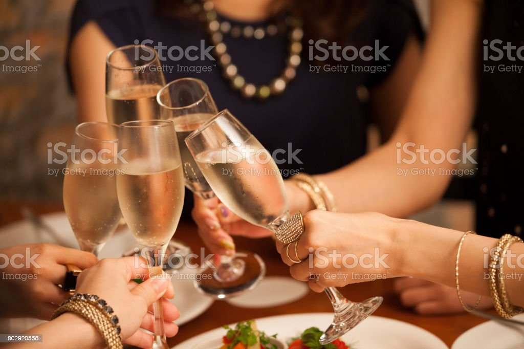 Close-up of the hands of the girls making a toast. stock photo