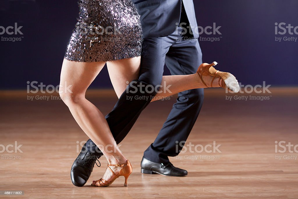 Closeup of the intertwined legs of two tango dancers stock photo