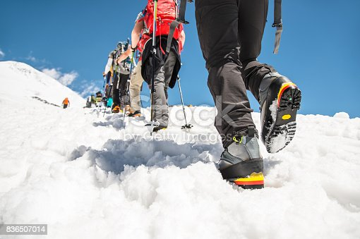istock Close-up of the legs of a group going uphill 836507014