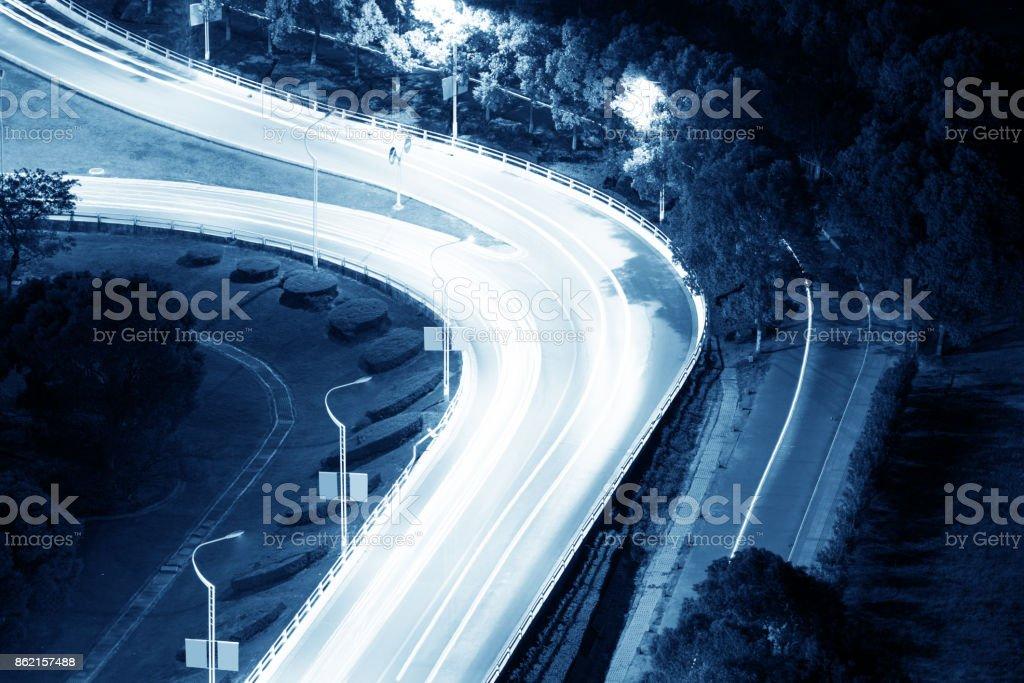 closeup of the light trails on grade separation bridge stock photo