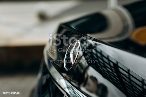 Berlin, August 29, 2018: A close-up of the Mercedes sign and the back of the new luxury black Mercedes-Benz car.