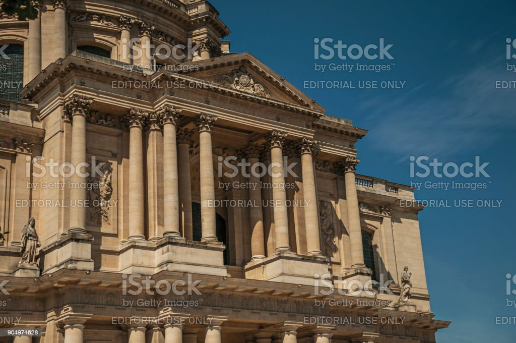 Close-up of the Neoclassical facade of Les Invalides Palace in a sunny day and blue sky at Paris. stock photo