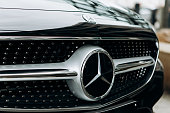 Berlin, August 29, 2018: A close-up of the Mercedes Benz sign on the new black Mercedes-Benz SLC. The inscription in German is translated as young stars.