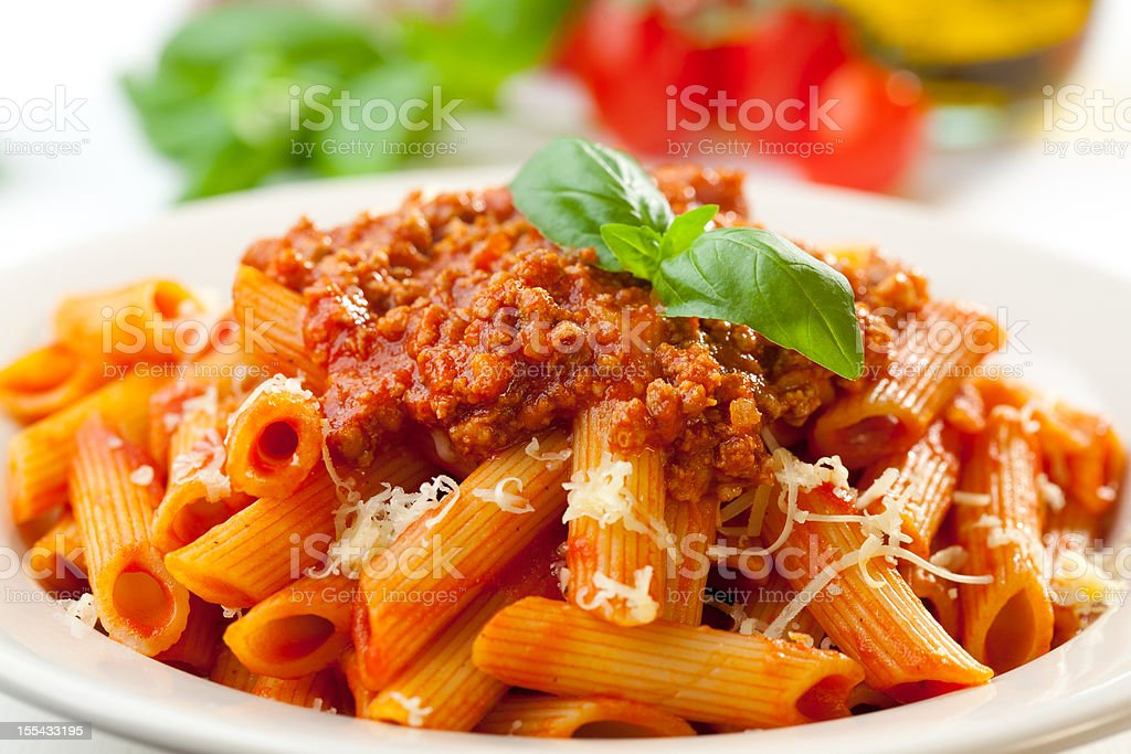 Close-up of the orange-toned penne Bolognese stock photo