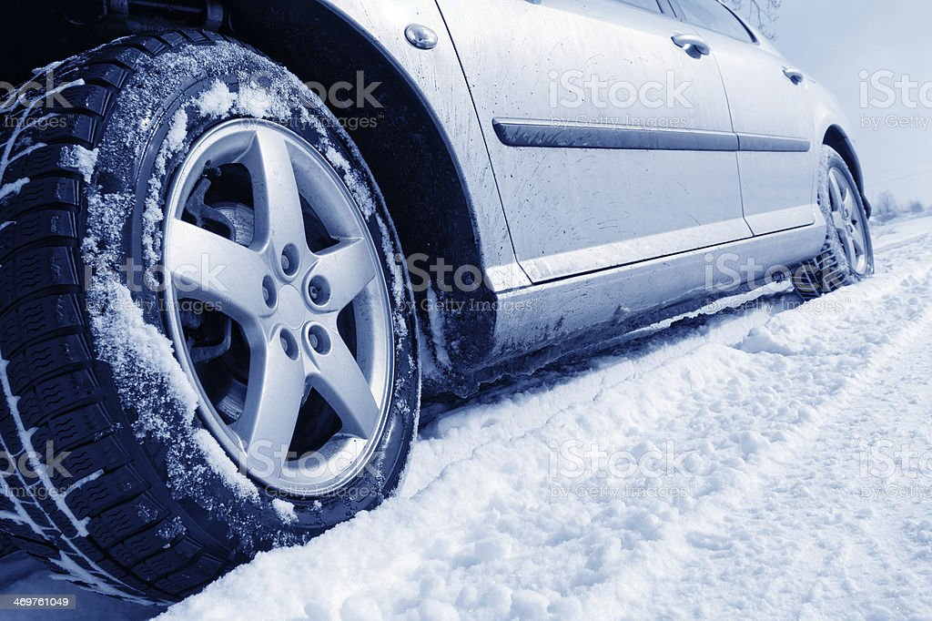 Close-up of the passenger side of a car on a snowy day stock photo