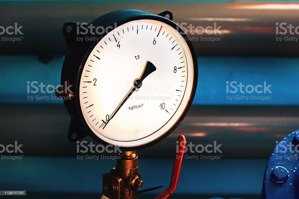 Closeup Of The Pressure Gauge On The Background Of Pipes The Gauge