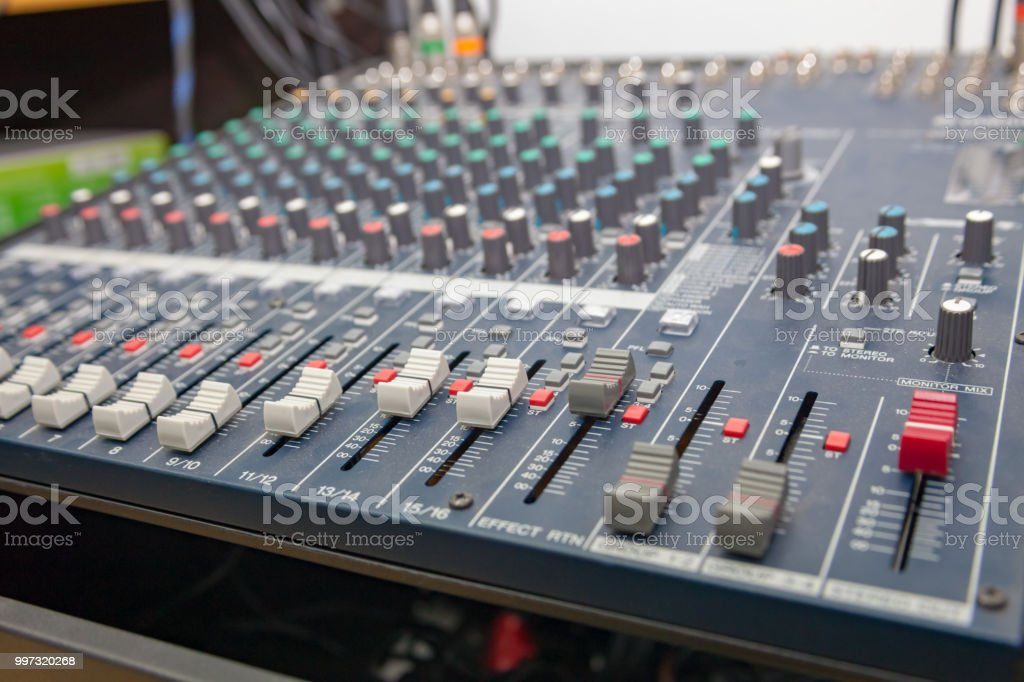 Closeup of the professional audio mixing console. Selective focus. stock photo