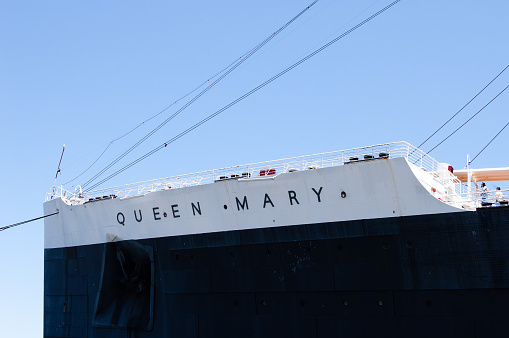 Long Beach, CA, USA - June 20, 2015: The bow of The Queen Mary, an iconic 1936 ocean liner moored at Long Beach, CA. The ship is now a floating hotel and host to a variety of events and home to numerous restaurants.