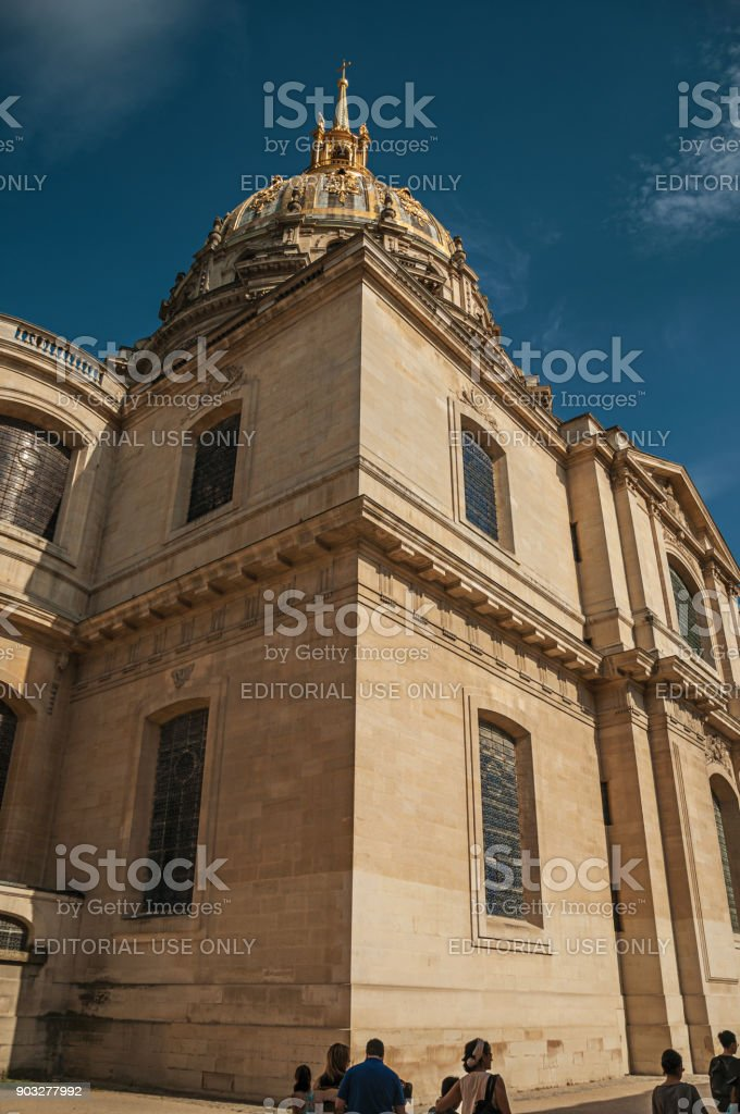Close-up of the side facade and golden dome of Les Invalides Palace with a sunny blue sky at Paris. stock photo