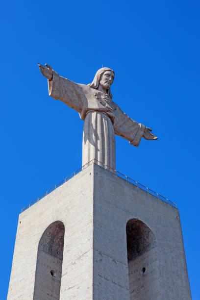 close-up of the statue of christ placed on top of the cristo-rei or king-christ sanctuary in almada. - cristo rei lisboa imagens e fotografias de stock