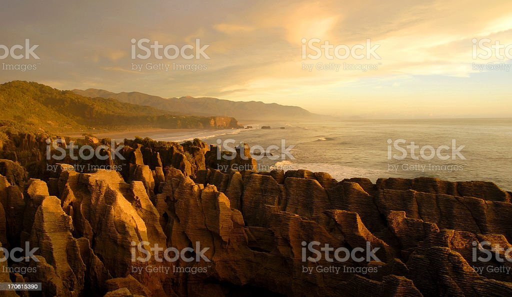 Close-up of the tan rocky shores of a New Zealand beach stock photo