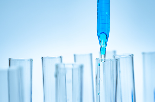 Close-up of the test tube on a blue background
