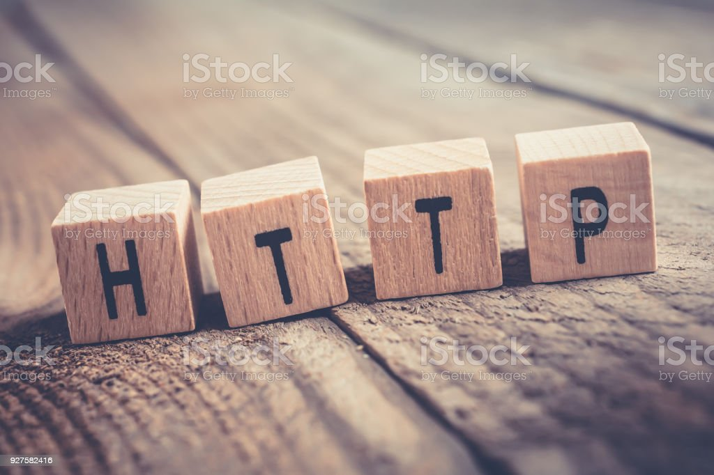 Closeup Of The Word HTTP Formed By Wooden Blocks On A Wooden Floor stock photo