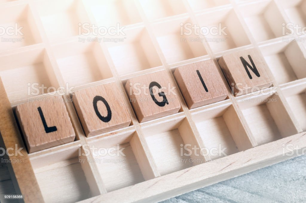 Closeup Of The Word Login Formed By Wooden Blocks In A Typecase stock photo