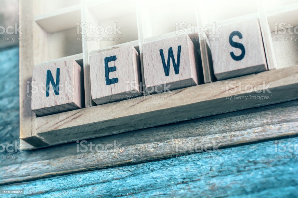 Closeup Of The Word News Formed By Wooden Blocks In A Typecase stock photo
