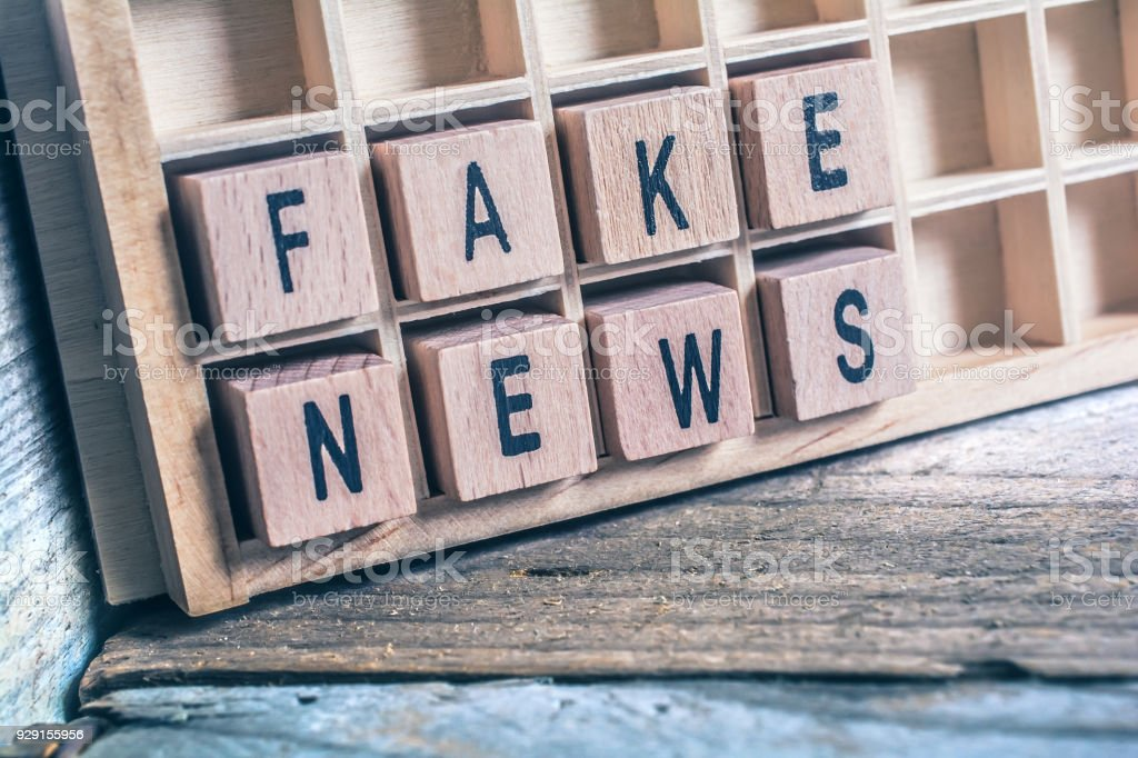 Closeup Of The Words Fake News Formed By Wooden Blocks In A Type Case stock photo